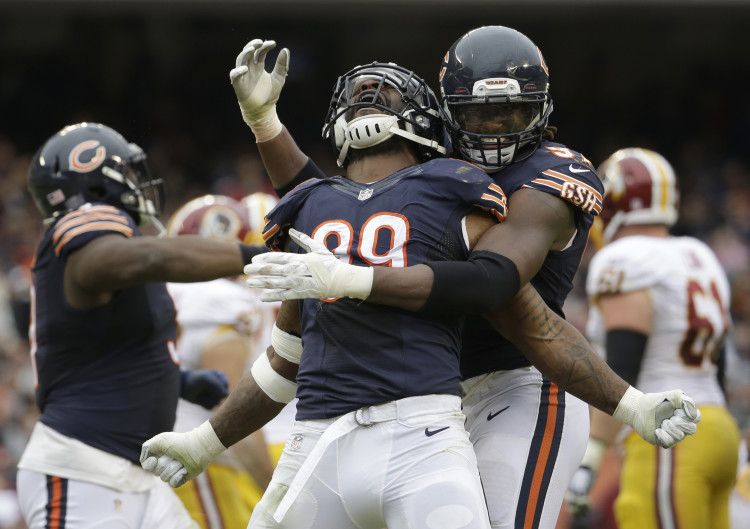 Lamarr Houston had his best game of the year, earning a sack and making five tackles. (AP Photo/Nam Y. Huh)